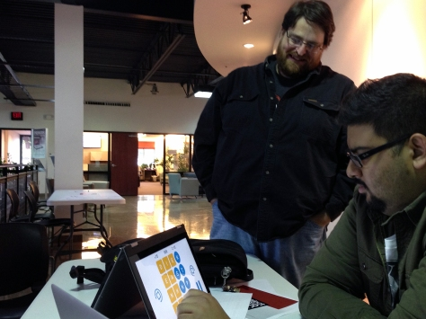 Dave Balmer, left, displays Word Rave at the Education Hackathon event.
