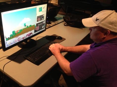 Heath McKinney demonstrates the gameplay of Dino Panic.